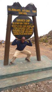 David Thuo Climbing Mt Kilimanjaro at the Baranco camp